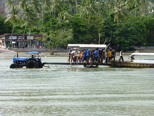 The workers on the island are ferried from the boats to land using a rolling platform pulled by a tractor. We had to walk through the water.