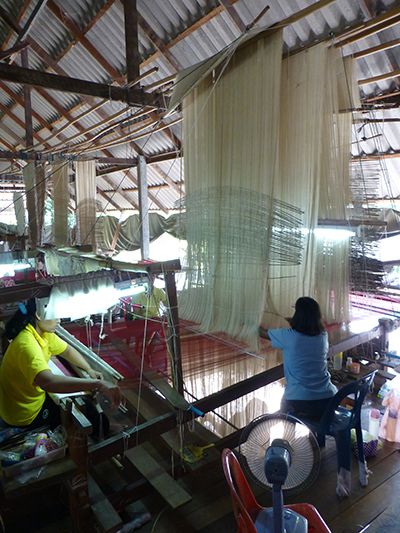 A couple of the women weaving. We are still not sure what everything is for, we did not get an explanation.