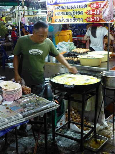 This guy made some sort of egg dish all night on this giant frying pan.