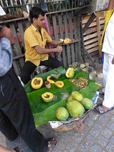We didn't try any of this fruit, but the sidewalks were filled with guys like this selling all kinds of Indian foods.