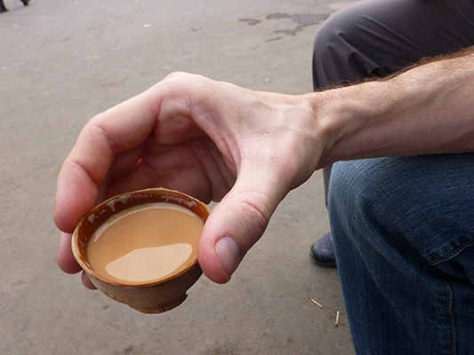 Close up of the clay cup filled with chai.