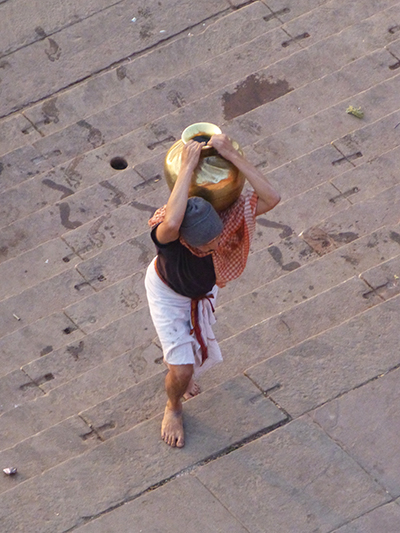 Man carrying water from Ganges in a pretty impressive golden pot.