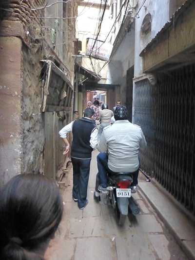One of the many narrow paths in the old city shared by people, cows and motorbikes.