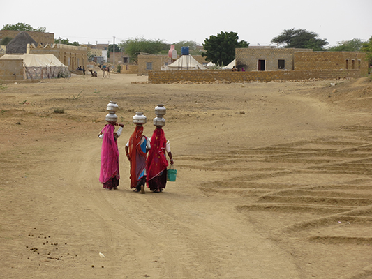 Some of the local women carrying water back to their homes.