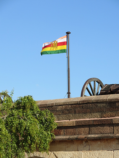 Flag flying on the fort wall.