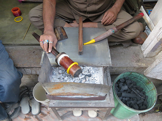 This guy was making bangles by hand to sell in his store. So much is still made by hand in India.