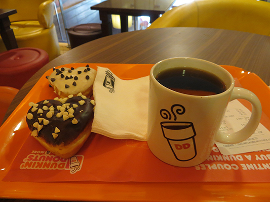 There was a Valentine's Day promotion going on. If you buy one Love Nut donut you get the second for free. Sweet. By the way, the coffee tastes just like it does in the U.S.