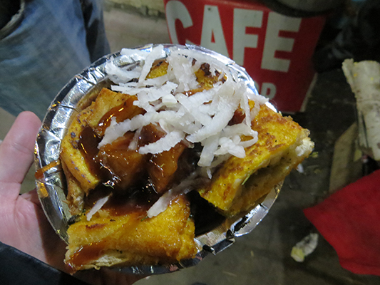 Yummy street food. Potato sandwich with a side of potatoes.