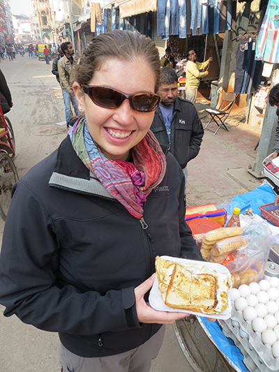 Happy customer with her bread omelette in hand.