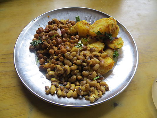 One of my favorite quick eats in Nepal. It consists of chickpeas, potatoes and beans. Yummy.