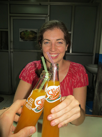 "Sarah and I saying ""cheers"" to the great time we had in Nepal and enjoying our favorite mango drink."