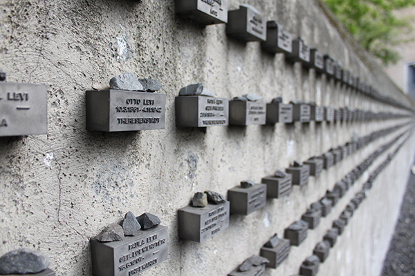 This was a very large wall with all of the people killed during the holocaust.
