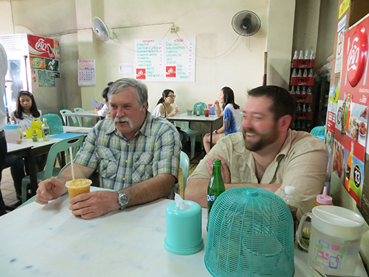 Phil and Jonathan waiting for their first meal in Thailand.