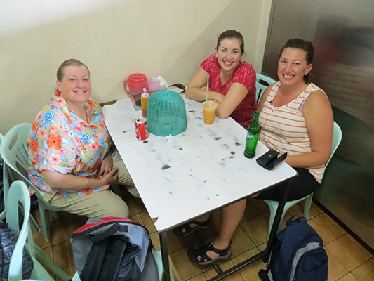 Karen, Sarah, and Jen waiting for their first meal in Thailand. Not actually Sarah's first meal there.