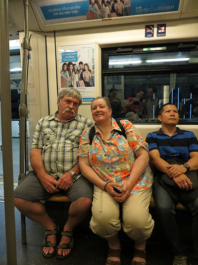 Phil and Karen riding the BTS train system in Bangkok.