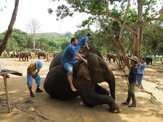 Jonathan mounting the elephant.
