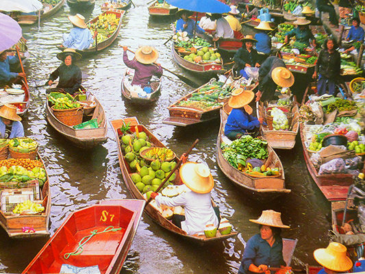 What we imagined the floating market would be. This is an old post card that Jen took a photo of. The Thailand of old.