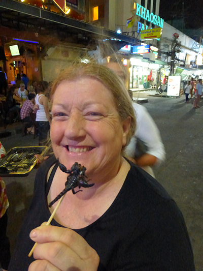 Karen accepting the challenge to eat a scorpion. Well done.